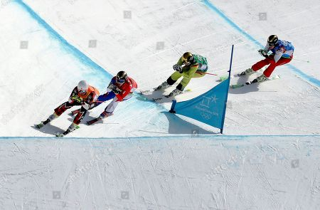 From left; Dave Duncan, of Canada, Jean Frederic Chapuis, of France, Paul Eckert, of Germany, and Russian athlete Egor Korotkov run the course during the men's ski cross elimination round at Phoenix Snow Park at the 2018 Winter Olympics in Pyeongchang, South Korea