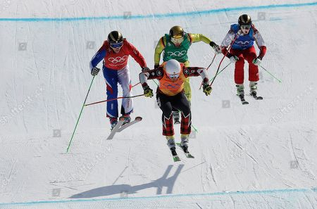 From left; Jean Frederic Chapuis, of France, Dave Duncan, of Canada, Paul Eckert, of Germany, and Russian athlete Egor Korotkov run the course during the men's ski cross elimination round at Phoenix Snow Park at the 2018 Winter Olympics in Pyeongchang, South Korea