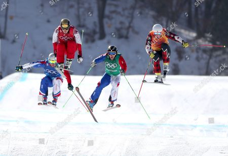 (L-R) Francois Place of France, Sergey Ridzik of Olympic Athletes of Russia, Jean Frederic Chapuis of France and Dave Duncan of Canada in action during the men's Freestyle Skiing Ski Cross quarterfinals at the Bokwang Phoenix Park during the PyeongChang 2018 Olympic Games, South Korea, 21 February 2018.