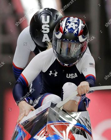 Driver Jamie Greubel Poser and Aja Evans of the United States start their third heat during the women's two-man bobsled final at the 2018 Winter Olympics in Pyeongchang, South Korea
