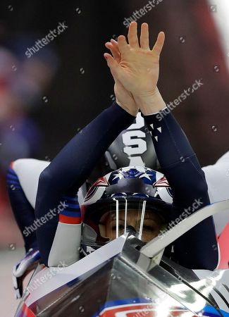 Stock Picture of Driver Jamie Greubel Poser and Aja Evans of the United States start their third heat during the women's two-man bobsled final at the 2018 Winter Olympics in Pyeongchang, South Korea