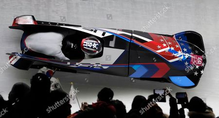 Driver Jamie Greubel Poser and Aja Evans of the United States take a curve in their third heat during the women's two-man bobsled final at the 2018 Winter Olympics in Pyeongchang, South Korea