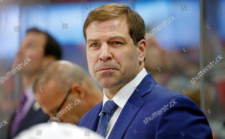 The New York Islanders head coach Doug Weight watches from the bench during the first period of an NHL hockey game against the Carolina Hurricanes, in Raleigh, N.C