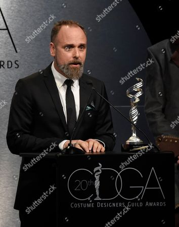 Luis Sequeira presents the distinguished collaborator award at the 20th annual Costume Designers Guild Awards at The Beverly Hilton hotel, in Beverly Hills, Calif