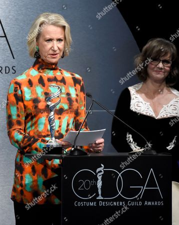 Joanna Johnston accepts the career achievement award as presenter Sally Field looks on at the 20th annual Costume Designers Guild Awards at The Beverly Hilton hotel, in Beverly Hills, Calif