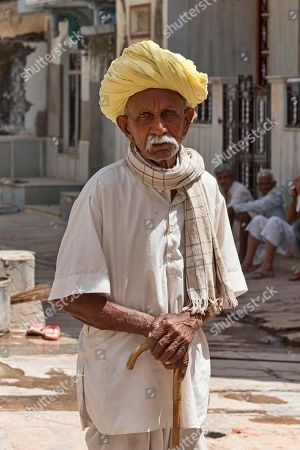 Old man, street scene, Bera, Rajasthan, India