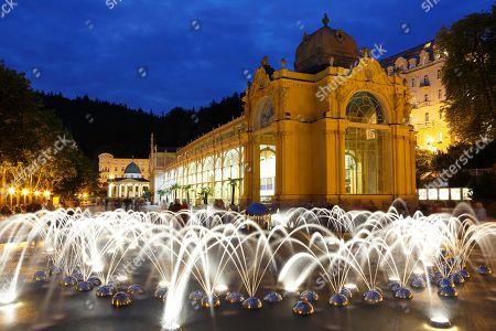 Evening mood, musical fountain, illuminated fountain with colonnade, new colonnade, Nova kolonada, main colonnade, Marianske Lazne, Bohemia, Czech Republic