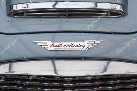 Austin Healey emblem with Logo on a Roadster, British classic car