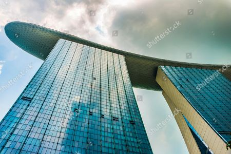 Futuristic outer facade of luxury Marina Bay Sands Hotel, designed by architect Moshe Safdie in Marina Bay, Downtown Core, Singapore