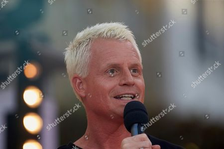 Stock Picture of Humorist and author Guido Cantz at the microphone, Mayen, Rhineland-Palatinate, Germany