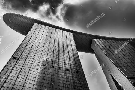Stock Picture of Futuristic outer facade of luxury Marina Bay Sands Hotel, designed by architect Moshe Safdie in Marina Bay, Downtown Core, Singapore