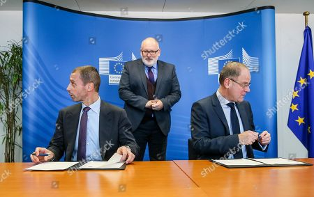 UEFA President Alexander Ceferin (L), European Commission Vice-President Frans Timmermans (C) and EU Education Commissioner, Hungarian Tibor Navracsics during a signing ceremony between EU and UEFA on an agreement for cooperation at the European Commission in Brussels, Belgium, 21 February 2018.