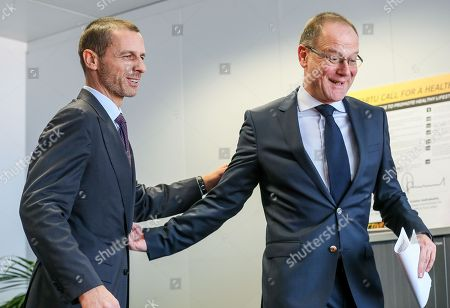 UEFA President Alexander Ceferin (L) and EU Education Commissioner, Hungarian Tibor Navracsics, attend a signing ceremony between EU and UEFA on an agreement for cooperation at the European Commission in Brussels, Belgium, 21 February 2018.