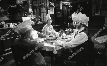 Stock Image of Ep 0282 Tuesday 23rd December 1975 Christmas party at The Woolpack. Landlord Amos Brearly comes up with a festive surprise when he dresses up as Father Christmas - With Annie Sugden, as played by Sheila Mercier ; Henry Wilks, as played by Arthur Pentelow ; Joe Sugden, as played by Frazer Hines ; Amos Brearly, as played by Ronald Magill ; Sam Pearson, as played by Toke Townley ; P.B, as played by Artro Morris.