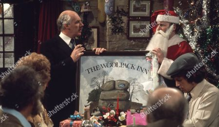 Stock Picture of Ep 0282 Tuesday 23rd December 1975 Christmas party at The Woolpack. Landlord Amos Brearly comes up with a festive surprise when he dresses up as Father Christmas - With Annie Sugden, as played by Sheila Mercier ; Henry Wilks, as played by Arthur Pentelow ; Joe Sugden, as played by Frazer Hines ; Amos Brearly, as played by Ronald Magill ; Sam Pearson, as played by Toke Townley ; P.B, as played by Artro Morris.
