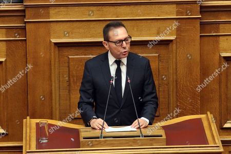 Bank of Greece (BoG) governor Yannis Stournaras speaks during a parliament's debate on the proposal of the government majority to set up a preliminary investigation commission for the Novartis case, in Athens, Greece, 21 February 2018. The debate was on whether Bank of Greece (BoG) governor Yannis Stournaras, two former prime ministers and another seven former ministers should be investigated by a preliminary committee for liability in the Novartis alleged bribery and money laundering case.