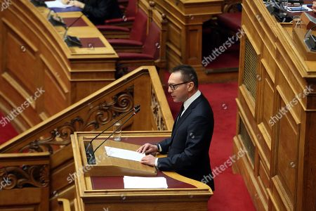 Stock Photo of Bank of Greece (BoG) governor Yannis Stournaras speaks during a parliament's debate on the proposal of the government majority to set up a preliminary investigation commission for the Novartis case, in Athens, Greece, 21 February 2018. The debate was on whether Bank of Greece (BoG) governor Yannis Stournaras, two former prime ministers and another seven former ministers should be investigated by a preliminary committee for liability in the Novartis alleged bribery and money laundering case.