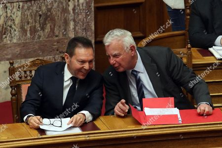 Former PM Panayotis Pikramenos (R) speaks with Bank of Greece governor Yannis Stournaras during the debate on the proposal of the government majority to set up a preliminary investigation commission for the Novartis case, in Athens, Greece, 21 February 2018. The debate was on whether Bank of Greece (BoG) governor Yannis Stournaras, two former prime ministers and another seven former ministers should be investigated by a preliminary committee for liability in the Novartis alleged bribery and money laundering case.