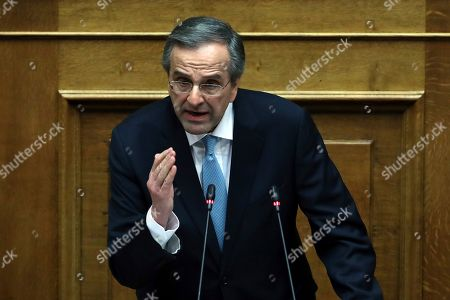 Former Prime Minister Antonis Samaras delivers a speech during a parliament session in Athens, . Greek lawmakers were debating Wednesday whether to launch an investigation into 10 senior politicians ? including Samaras, one more former prime minister, the current central bank governor and a European commissioner ? over allegations they were involved in a pharmaceutical bribery scandal