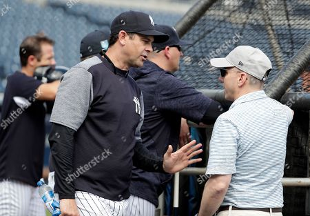 Aaron Boone, Brian Cashman. New York Yankees manager Aaron Boone talks with Yankees General Manager Brian Cashman at baseball spring training camp, in Tampa, Fla