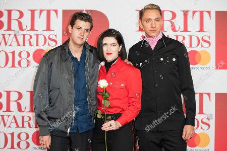 Romy Madley Croft, Oliver Sim, Jamie Smith. Romy Madley Croft, Oliver Sim and Jamie Smith of the XX pose for photographers upon arrival at the Brit Awards 2018 in London