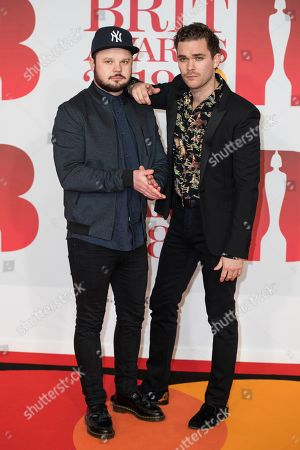 Mike Kerr, Ben Thatcher. Mike Kerr and Ben Thatcher of Royal Blood pose for photographers upon arrival at the Brit Awards 2018 in London