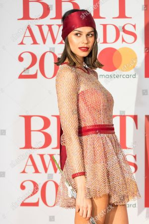 Katie Keight poses for photographers upon arrival at the Brit Awards 2018 in London