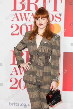 Chloe Howl poses for photographers upon arrival at the Brit Awards 2018 in London