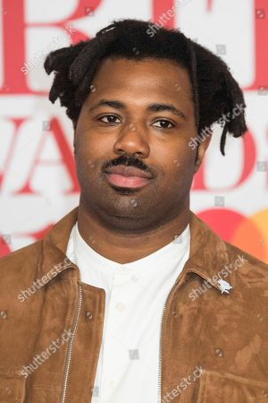 Sampha poses for photographers upon arrival at the Brit Awards 2018 in London