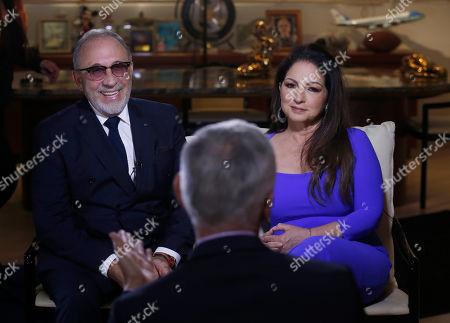 Emilio Estefan Jr., Gloria Estefan, Jorge Ramos. Emilio Estefan, left, and Gloria Estefan appear during an interview with Jorge Ramos in their studio in Miami