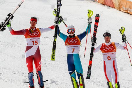 Silver medalist Daniel Yule, of Switzerland, left, gold medalist Andre Myhrer, of Sweden, and bronze medalist Michael Matt, of Austria, celebrate in the finish area after thier final run of the men's slalom at the 2018 Winter Olympics in Pyeongchang, South Korea
