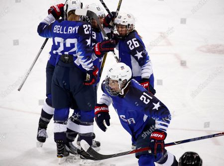 Hilary Knight (21), of the United States, celebrates with her teammates after scoring a goal during the first period of the women's gold medal hockey game against Canada at the 2018 Winter Olympics in Gangneung, South Korea