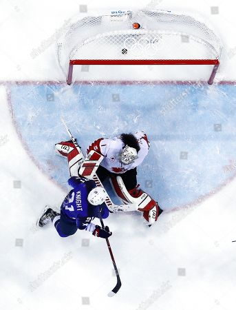Hilary Knight (B) of the US scores the opening goal against Shannon Szabados of Canada during the Women's Ice Hockey Gold Medal match between Canada and USA inside the Gangneung Hockey Centre at the PyeongChang Winter Olympic Games 2018, in Gangneung, South Korea, 22 February 2018.