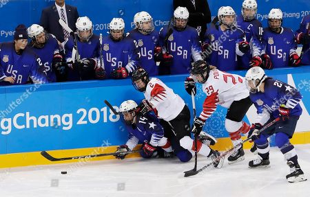 Hilary Knight (R) and Brianna Decker (L) of the US in action against Meghan Agosta (2L) and Marie-Philip Poulin of Canada as US players look on during the Women's Ice Hockey Gold Medal match between Canada and USA inside the Gangneung Hockey Centre at the PyeongChang Winter Olympic Games 2018, in Gangneung, South Korea, 22 February 2018.