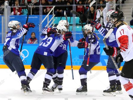 Hilary Knight of the USA (2-R, partially obsscured) celebrates with teammates after scoring the opening goal during the Women's Ice Hockey Gold medal match between Canada and the USA at the Gangneung Hockey Centre during the PyeongChang 2018 Winter Olympic Games, in Gangneung, South Korea, 22 February 2018.