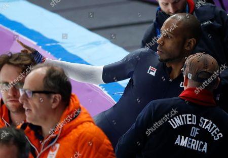 Shani Davis of the U.S. talks to his coach during a practice session for the men's 1,000 meters speedskating race at the Gangneung Oval at the 2018 Winter Olympics in Gangneung, South Korea