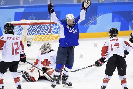 Meaghan Mikkelson (left), goalie Shannon Szabados and Bailey Bram (right) of Canada and Hilary Knight of USA during the Women's Ice Hockey Gold Medal Game between Canada and the United States