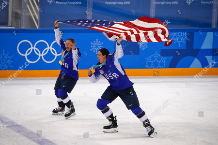United States' Kendall Coyne, left, and Hilary Knight celebrate after winning the women's gold medal hockey game against Canada at the 2018 Winter Olympics in Gangneung, South Korea
