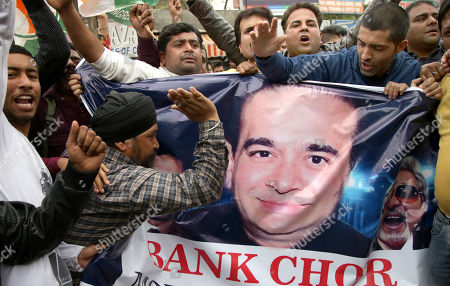 Indian Youth Congress activists hold posters of jeweler Nirav Modi and shout slogans against the government during a protest against Bhartiya Janta Party (BJP) led government in Jammu, the winter capital of Kashmir, India, 22 February 2018. According to a news report, activists protested against the fraud sceme allegedly orchastrated by Nirav Modi, worth 1.77 billion US dollar at India's second-biggest state-run bank Punjab National Bank (PNB) branch in Mumbai, blaming the Indian government for their alleged involvement.