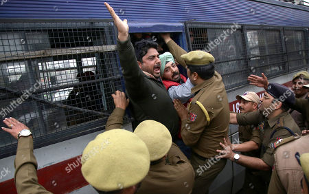 Jammu and Kashmir police men detain Indian Youth Congress activists during a protest against the Bhartiya Janta Party (BJP) led government in Jammu, the winter capital of Kashmir, India, 22 February 2018. According to a news report, activists protested against the fraud sceme allegedly orchastrated by Nirav Modi, worth 1.77 billion US dollar at India's second-biggest state-run bank Punjab National Bank (PNB) branch in Mumbai, blaming the Indian government for their alleged involvement.