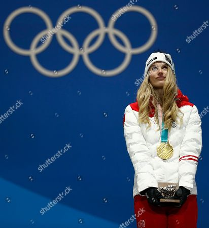 Gold medalist in the women's Big Air snowboard Anna Gasser, of Austria looks up during the medals ceremony at the 2018 Winter Olympics in Pyeongchang, South Korea