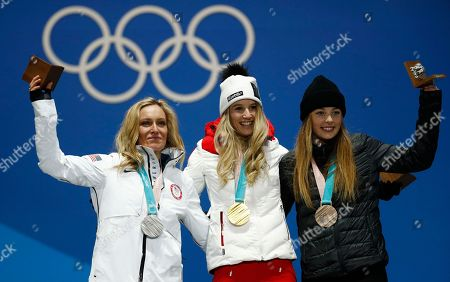 Medalists in the women's Big Air snowboard, United States' Jamie Anderson, silver, at left, Austrias' Anna Gasser, gold, center, and New Zealand's Synnott Zoi Sadowski, bronze, pose during their medals ceremony at the 2018 Winter Olympics in Pyeongchang, South Korea