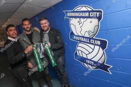 Former Birmingham City player Roger Johnson with Chris Kamara and Darren Farley at the Carabao Cup Trophy Relay at St Andrews, Birmingham