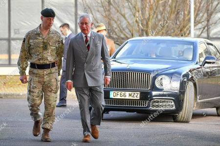 Prince Charles arrives, accompanied by Commander Allied Rapid reaction Corps Lieutenant General Tim Radford CB DSO OBE, during a visit to the headquarters of the Allied Rapid Reaction Corps