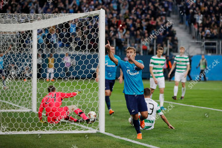 Zenit's Aleksandr Kokorin celebrates scoring his side's third goal during the Europa League round of 32 second leg soccer match between Zenit St. Petersburg and Celtic at the Saint Petersburg stadium, in St. Petersburg, Russia