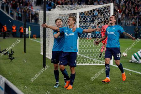 Zenit's Aleksandr Kokorin, center, celebrates scoring his side's third goal during the Europa League round of 32 second leg soccer match between Zenit St. Petersburg and Celtic at the Saint Petersburg stadium, in St. Petersburg, Russia