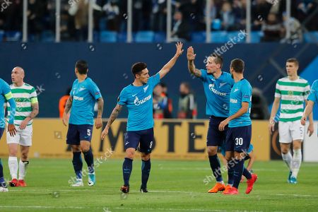 Zenit's Daler Kuzyayev, third right, celebrates scoring his side's second goal during the Europa League round of 32 second leg soccer match between Zenit St. Petersburg and Celtic at the Saint Petersburg stadium, in St. Petersburg, Russia