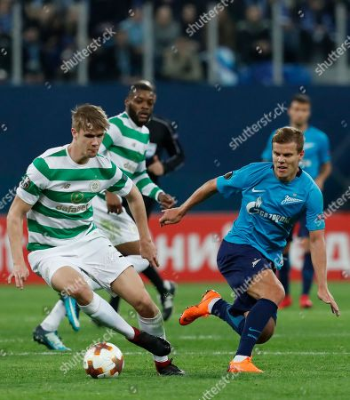 Kristoffer Ajer of Celtic (L) in action against Aleksandr Kokorin of FC Zenit during the UEFA Europa League round of 32, second leg soccer match between Zenit Saint Petersburg and Celtic Glasgow, in St. Petersburg, Russia, 22 February 2018.