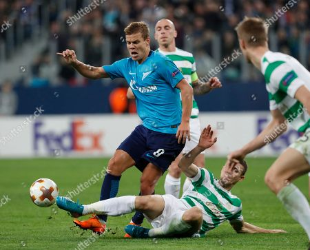 Jozo Simunovic of Celtic (R) in action against Aleksandr Kokorin of FC Zenit (L) during the UEFA Europa League round of 32, second leg soccer match between Zenit Saint Petersburg and Celtic Glasgow, in St. Petersburg, Russia, 22 February 2018.