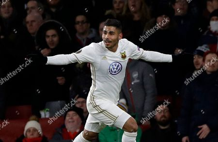 Ostersunds' Hosam Aiesh, celebrates after the own goal by Arsenal's Calum Chambers during the Europa League Round of 32, second leg soccer match between Arsenal and Ostersunds FK at the Emirates Stadium in London